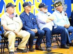 Photo by Mike Eckels A group of military veterans from the Howard-Parrish Veterans of Foreign Wars Post 9834 in Decatur watch a video presentation during the second annual Decatur High School Veterans Day Assembly at Peterson Gym in Decatur Nov. 11.