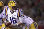 LSU's Danny Etling (16) turns back to hand off the ball during the first half of an NCAA college football game against Arkansas, Saturday, Nov. 12, 2016, in Fayetteville, Ark. (AP Photo/Samantha Baker)