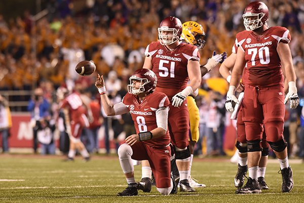 Arkansas linemen Hjalte Froholdt (51) and Dan Skipper (70) watch as quarterback Austin Allen (8) flips the ball to an official after he was sacked during a game against LSU on Saturday, Nov. 12, 2016, in Fayetteville.