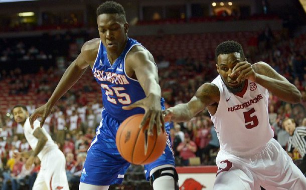 NWA Democrat-Gazette/BEN GOFF @NWABENGOFF Arlando Cook (5) of Arkansas tries to steal from Kevin Hervey (25) of UT Arlington on Friday Nov. 18, 2016 during the game in Bud Walton Arena in Fayetteville.