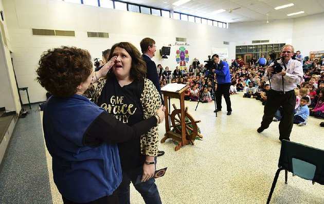 kara-davis-a-fourth-grade-teacher-at-mathias-elementary-school-in-rogers-gets-a-hug-from-principal-betsy-kinkade-after-davis-learned-she-was-one-of-35-people-in-the-us-to-receive-this-years-milken-educator-award