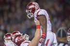 Arkansas offensive lineman Frank Ragnow (72) lifts running back Rawleigh Williams (22) in celebration following a touchdown by Williams against Mississippi State on Saturday, Nov. 19, 2016, at Davis Wade Stadium in Starkville, Miss., during the first quarter