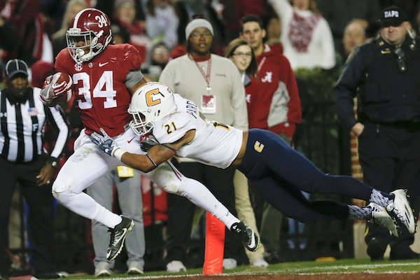 alabama-running-back-damien-harris-right-scores-a-touchdown-against-chattanooga-defensive-back-montrell-pardue-during-the-second-half-of-an-ncaa-college-football-game-saturday-nov-19-2016-in-tuscaloosa-ala