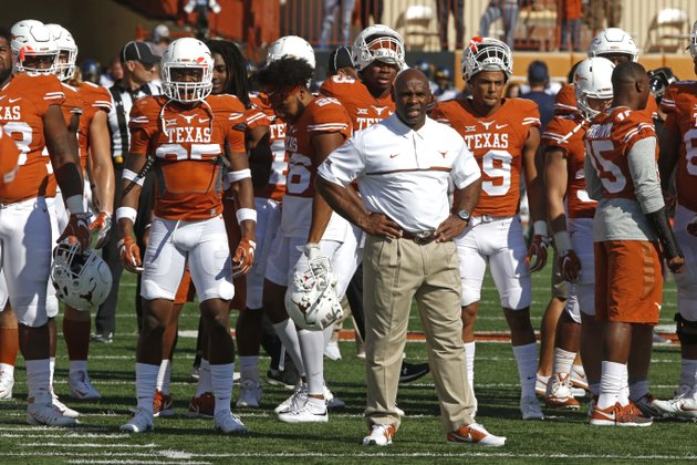 texas-head-coach-charlie-strong-stands-with-his-players-before-the-start-of-an-ncaa-college-football-game-against-west-virginia-saturday-nov-12-2016-in-austin-texas-ap-photomichael-thomas