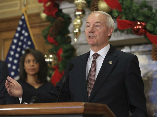 arkansas-democrat-gazettestaton-breidenthal-112116-gov-asa-hutchinson-right-answers-questions-from-the-media-monday-at-the-state-capitol-after-announcing-the-appointment-of-kimberly-oguinn-left-to-the-public-service-commission