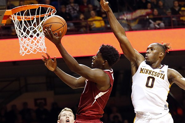 Arkansas' Jaylen Barford shoots in front of Minnesota's Akeem Springs during the first half of an NCAA college basketball game Tuesday, Nov. 22, 2016, in Minneapolis. (AP Photo/Jim Mone)