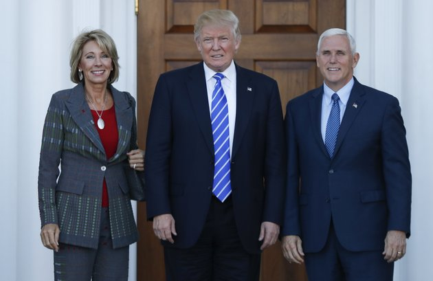 file-in-this-nov-19-2016-file-photo-president-elect-donald-trump-vice-president-elect-mike-pence-and-betsy-devos-pose-for-photographs-at-trump-national-golf-club-bedminster-clubhouse-in-bedminster-nj-trump-has-chosen-charter-school-advocate-devos-as-education-secretary-in-his-administration-ap-photocarolyn-kaster-file