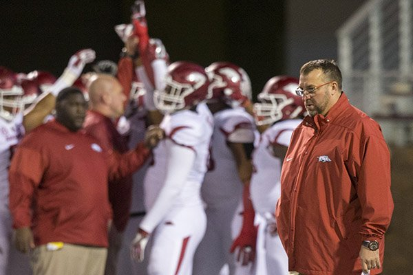 arkansas-coach-bret-bielema-watches-as-players-prepare-to-take-the-field-for-warmups-prior-to-a-game-against-mississippi-state-on-saturday-nov-19-2016-in-starkville-miss