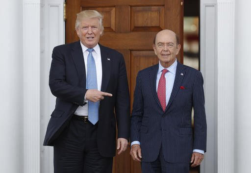 in-this-sunday-nov-20-2016-file-photo-president-elect-donald-trump-left-stands-with-investor-wilbur-ross-after-meeting-at-the-trump-national-golf-club-bedminster-clubhouse-in-bedminster-nj-trump-is-poised-to-offer-the-position-of-commerce-secretary-to-the-head-of-a-private-equity-firm-wilbur-ross