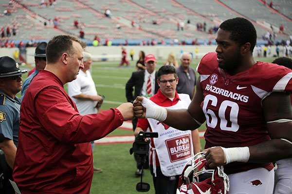 arkansas-coach-bret-bielema-left-congratulates-offensive-lineman-brian-wallace-as-he-leaves-the-field-following-a-game-against-alcorn-state-on-saturday-oct-1-2016-in-little-rock