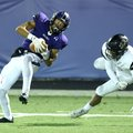 Fayetteville receiver Brennan Lewis (2) hauls in a pass for a touchdown as Bentonville High defender...