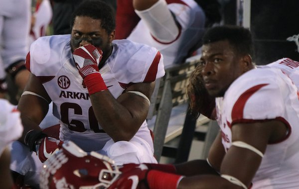 Arkansas players including Brian Wallace, (60) and Jeremy Sprinkle, right, react on the sidelines after a disappointing loss to Missouri Friday in Columbia, Mo.
