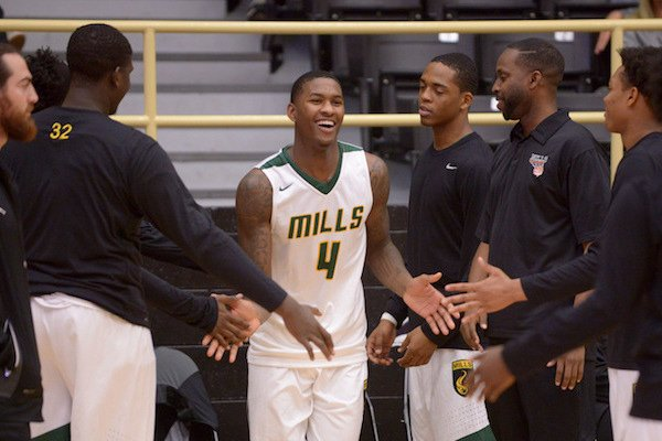 Darious Hall of Little Rock Mills takes the court during introductions on Saturday Nov. 26, 2016 before the game against Bentonville in the Bentonville Showcase basketball tournament in Bentonville's Tiger Arena.