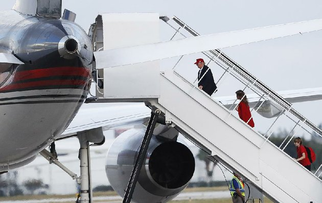 president-elect-donald-trump-followed-by-his-wife-melania-and-son-barron-board-his-plane-at-palm-beach-international-airport-on-sunday-in-west-palm-beach-fla-en-route-to-new-york