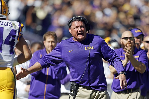 LSU interim head coach Ed Orgeron cheers from the sideline after a score in the first half an NCAA college football game against Florida in Baton Rouge, La., Saturday, Nov. 19, 2016. Florida won 16-10. (AP Photo/Gerald Herbert)