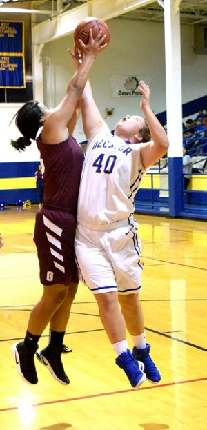 Photo by Mike Eckels Chastery Fuamatu (Gentry 25) and Cameron Shaffer (Decatur 40) fight for possession of the basketball during the Nov. 22 Lady Bulldog-Lady Pioneer matchup at Peterson Gym in Decatur.