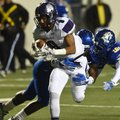 Fayetteville High receiver Terrance Rock is tackled just short of the end zone Friday, Dec. 2, 2016,...