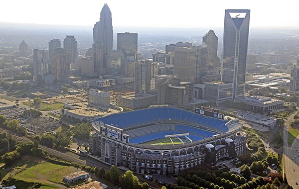In this Aug. 16, 2012 file photo, the skyline of Charlotte, N.C., rises behind Bank of America Stadium in this aerial photo. The Belk Bowl will be played at the stadium on Thursday, Dec. 29, 2016. (AP Photo/Chuck Burton, File)
