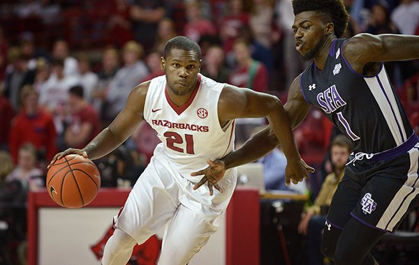 Arkansas' Manny Watkins (21) drives during a game against Stephen F. Austin on Thursday, Dec. 1, 2016, in Fayetteville.