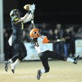 Isaac Disney (2) of Prairie Grove hauls in a pass over D'Shawn Jackson of Warren on Friday at Tiger ...