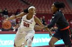 Jessica Jackson (00) of Arkansas drives down court as Ivonne Cook-Taylor (2) of Texas Tech guards on Saturday Dec. 3, 2016 during the game at Bud Walton Arena in Fayetteville.