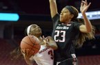 Malica Monk (3) of Arkansas shoots as Arella Guirantes (23) of Texas Tech defends on Saturday Dec. 3, 2016 during the game at Bud Walton Arena in Fayetteville.