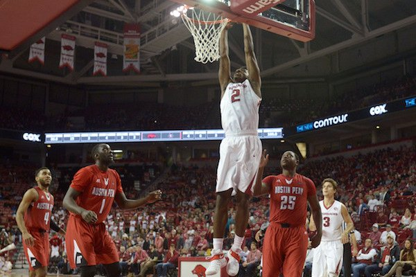 Adrio Bailey of Arkansas dunks against Austin Peay on Saturday Dec. 3, 2016 during the game at Bud Walton Arena in Fayetteville.