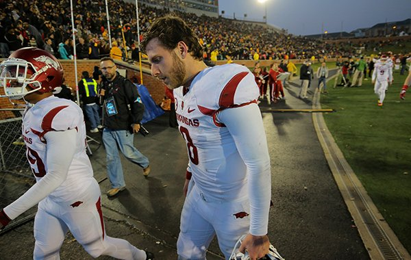 Arkansas quarterback Austin Allen walks off the field following a 28-24 loss to Missouri on Friday, Nov. 25, 2016, in Columbia, Mo.