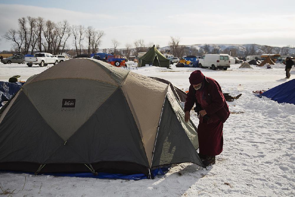 Marine Corps veteran Allan Newman enters his tent Saturday ...