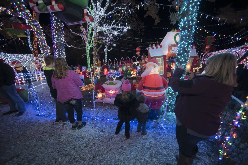 nwa democrat gazettejt wampler guests enjoy the scene at the stewart family holiday light display