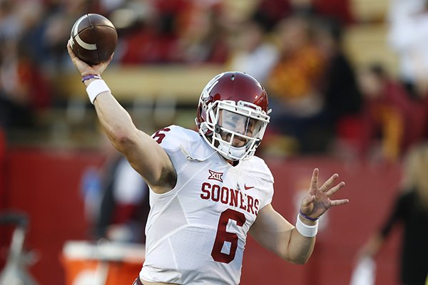 9447547c2 Oklahoma quarterback Baker Mayfield warms up before an NCAA college football  game against Iowa State
