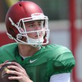 Arkansas quarterback Ricky Town participates in a drill during practice Saturday, Aug. 6, 2016, at t...