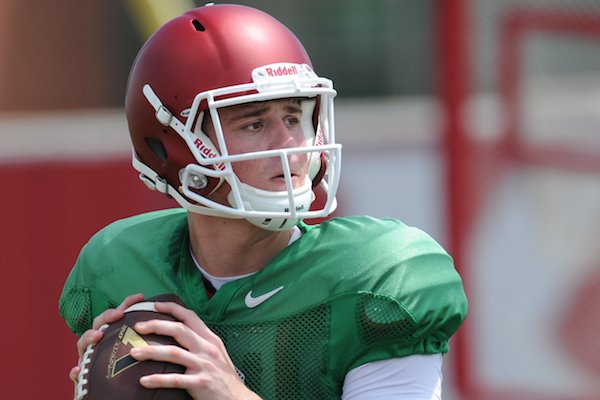 Arkansas quarterback Ricky Town participates in a drill during practice Saturday, Aug. 6, 2016, at the football practice field on the university campus in Fayetteville.