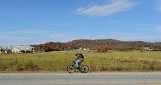 A cyclist rides ...