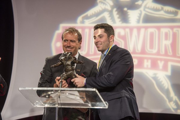 Baker Mayfield accepts the 2016 Burlsworth Trophy from Marty Burlsworth Monday, Dec. 5, 2016 at the Northwest Convention Center in Springdale. Mayfield, Oklahoma University junior quarterback, won the award for the second straight year.