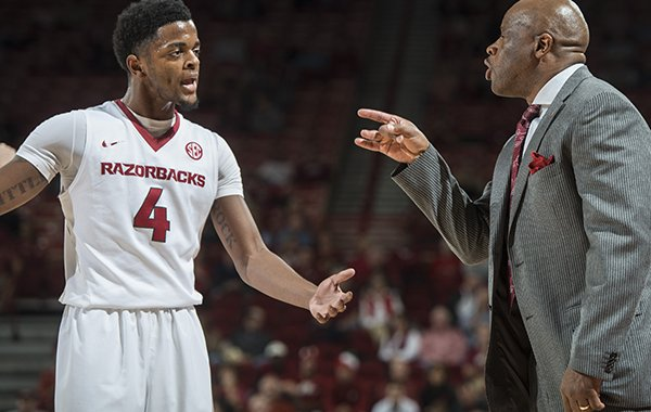 Arkansas coach Mike Anderson gives instructions to Daryl Macon (4) during a game against Houston on Tuesday, Dec. 6, 2016, at Bud Walton Arena in Fayetteville.