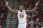 Arkansas center Moses Kingsley celebrates during the second half of a game against Houston on Tuesday, Dec. 6, 2016, in Fayetteville.