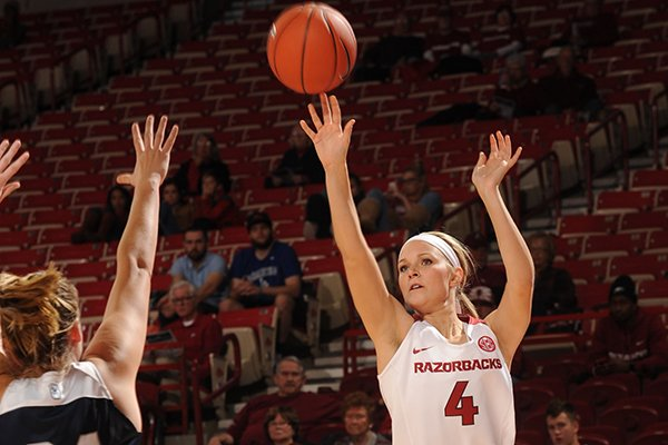 Keiryn Swenson (4) of Arkansas takes a 3-point shot over Tori Schickel of Butler Wednesday, Dec. 7, 2016, during the first half of play in Bud Walton Arena in Fayetteville.