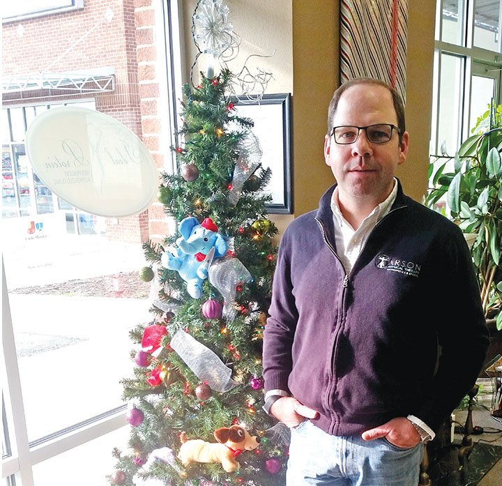 Local physical therapist helps donate toys to area children