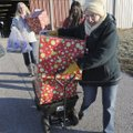 Volunteers Virginia Higginbotham (left) and Nancy Albin (right) deliver gifts Friday during Sharing ...