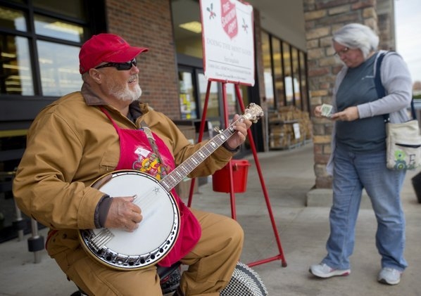 bluegrass musician picks and peals for salvation army - Bluegrass Christmas Songs