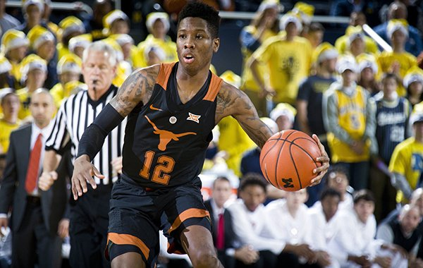 Texas guard Kerwin Roach Jr. (12) dribbles the ball in the first half of an NCAA college basketball game against Michigan at Crisler Center in Ann Arbor, Mich., Tuesday, Dec. 6, 2016. (AP Photo/Tony Ding)