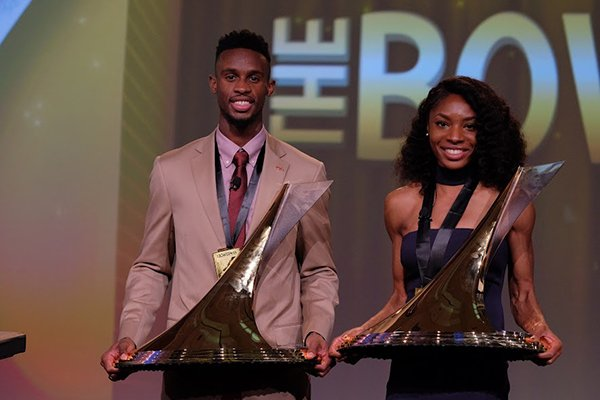 Jarrion Lawson, left, and Courtney Okolo pose with their Bowerman Awards during a banquet Friday, Dec. 16, 2016, in Orlando, Fla.