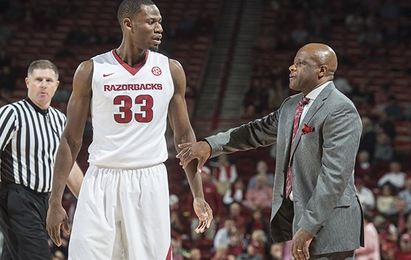 Arkansas head coach Mike Anderson talks with Moses Kingsley (33) of Arkansas between plays against Houston Tuesday, Dec. 6, 2016 at Bud Walton Arena in Fayetteville. The Razorbacks won 84-72.