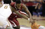 Arkansas' Arlando Cook (5) battles Texas' Tevin Mack (0) for a loose ball during the second half of an NCAA college basketball game Saturday, Dec. 17, 2016, in Houston. Arkansas won 77-74. (AP Photo/David J. Phillip)