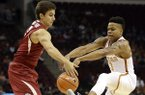 Arkansas' Dusty Hannahs, left, knocks the ball away from Texas' Jacob Young during the first half of an NCAA college basketball game Saturday, Dec. 17, 2016, in Houston. (AP Photo/David J. Phillip)