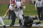 Arkansas wide receiver Drew Morgan (80) tries to slip out of a tackle from Missouri defensive back TJ Warren (2) on Friday, Nov. 25, 2016, at Faurot Field in Columbia, Mo., during the third quarter.