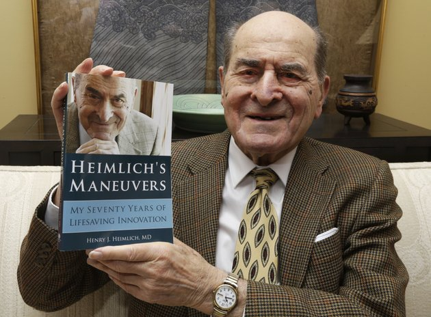 file-in-this-feb-5-2014-file-photo-dr-henry-heimlich-holds-his-memoir-prior-to-being-interviewed-at-his-home-in-cincinnati-heimlich-the-surgeon-who-created-the-life-saving-heimlich-maneuver-for-choking-victims-has-died-saturday-dec-17-2016-at-christ-hospital-in-cincinnati-he-was-96-ap-photoal-behrman-file