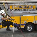 Lawson Osburn, Springdale firefighter, hangs from a rope as he practices his rope skills Friday at S...