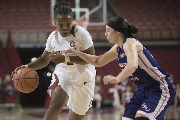 Arkansas' Aaliyah Wilson drives downcourt while Northwestern State's Beatrice Attura defends Sunday Dec. 18, 2016 at Bud Walton Arena in Fayetteville.